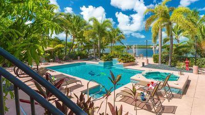 Expansive backyard with sun filled swimming pool,Jacuzzi and boat dockage.