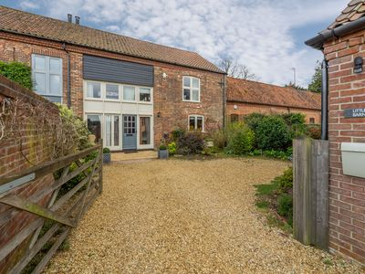 Photo for A beautifully presented four-bedroom barn conversion in a peaceful position in Stanhoe. The accommod
