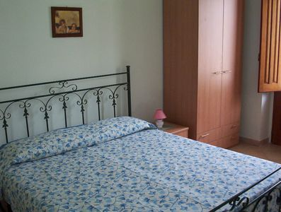 One of the three double bedrooms.