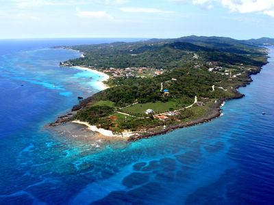 The Meridian located at the western most end of Roatan. Look at the reef!