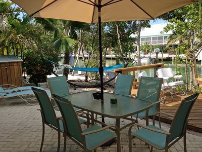 Patio w/ 2 chaise lounges, dining table, party deck, 4 king fish chairs & grill