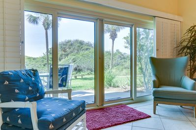 Beach Manor 0110 - Living Room - Sliding doors are emphasized to highlight the outside scenery that is made visible in the living room.
