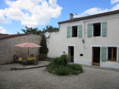 Photo for Rural Gite with private courtyard garden, Coulgens/St Angeau - sleeps 4 + baby
