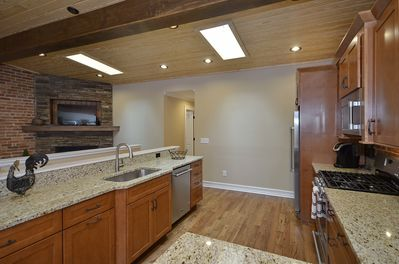 The open kitchen overlooks the living area and offers plenty of space to cook