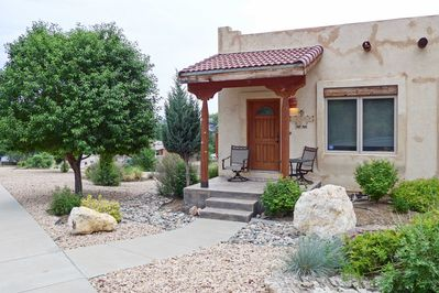 You'll immediately fall in love with the Santa-Fe style home's rustic charm.