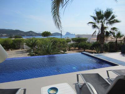 Photo for MODERN VILLA WITH SPECTACULAR VIEWS TO THE SEA AND ISLAND OF ES VEDRA AND POOL