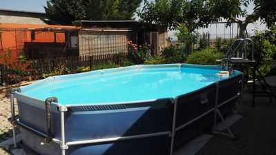 Photo for Pool, garden and barbecue
