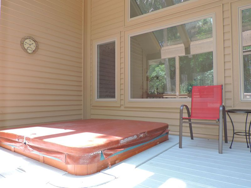 Screened in porch with a hot tub, private pool heated seasonally ...