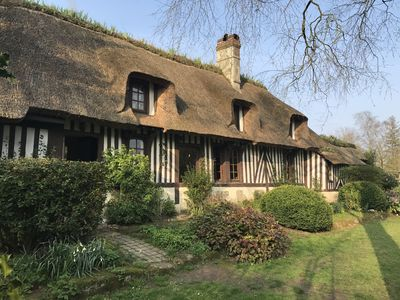 Photo for Norman thatched cottage surrounded by a large flowered garden with trees