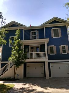Photo for New Listing Luxurious four bedroom home sleeps 11 people on a quiet side street