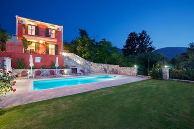 VIEW OF OUR PRIVATE POOL AND GARDEN WITH GRASS AT NIGHT