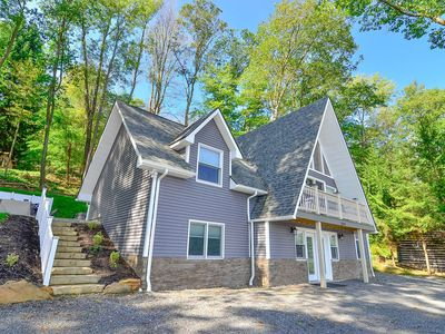 Photo for Split lakefront home in the heart of DCL, private dock, hot tub & fire pit!