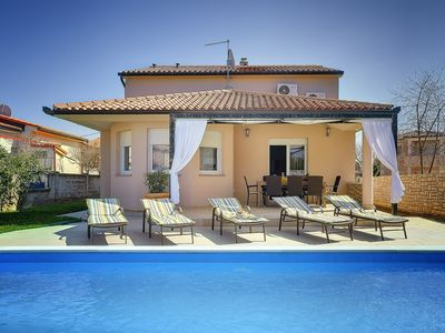 Photo for Villa with private pool, 4 bedrooms, air conditioning, darts, table football, WiFi, 4 bicycles, barbecue and only 590 meters to the pebble beach