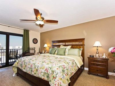 Photo for BREATHTAKING SUNSET GULF VIEWS AWAIT AT ISLAND WINDS! Click for reviews! 1,378 sq ft  plus 3 screened Lanais. Relax in total comfort!  FREE WIFI, CENTRAL AIR, FULL-SIZED WASHER AND DRYER IN UNIT