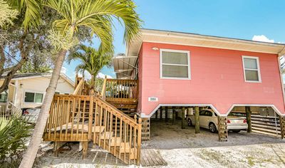 Pretty in Pink! Darling beachside cottage home located on the north end of Fort Myers Beach. This cozy, pet friendly 2 bedrooms/2 baths beach home sleeps 6 people.