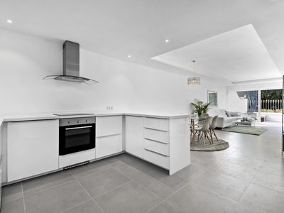 Photo for Stylish and modern holiday apartment walking distance to beach and amenities