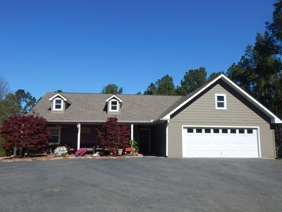 Photo for Secluded mountain getaway on 10 acres, only 3 miles to historic downtown!