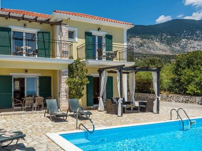 Photo for Breathtaking sea views, a short walk to nearby restaurants and shops this lemon coloured villa is a modern comfortable base for a quiet restful holiday. .