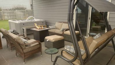 Fenced in yard with lots of space.  7 person hot tub with lots of furniture.