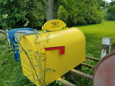 Look for the bright yellow mailbox