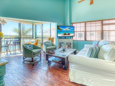 Photo for Family friendly waterfront penthouse sleeps 8 boat ramp private beach dock