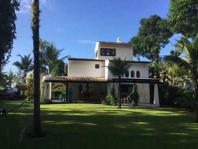 Photo for Spacious house at 70m from the beach, amidst a tropical garden