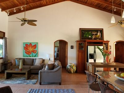 Main living area with open floorplan, cross view of mountains and pool area.