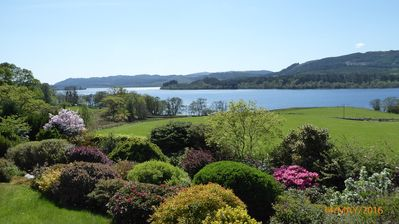 the cottage's garden full of azaleas and heathers and looking onto Loch Awe