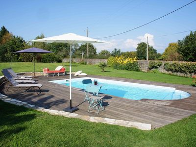 Photo for Holiday home with pool located in a quiet village surrounded by nature