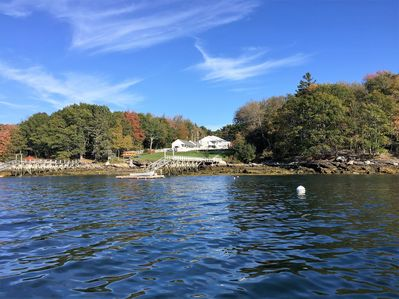 The property in early fall from the water of Linekin Bay