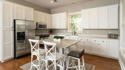 Newly renovated kitchen with quartz counters and white cabinets