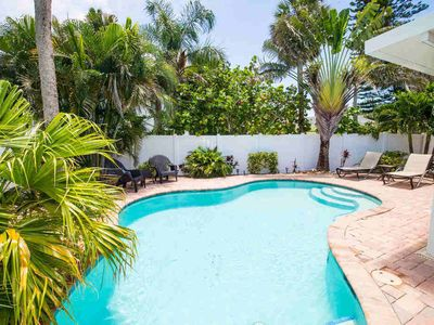 Photo for BOOK YOUR 2020 STAY TODAY! ADORABLE BEACH HOUSE IN THE CENTER OF ANNA MARIA ISLAND WITH PRIVATE POOL! LOCATED DIRECTLY ACROSS FROM WATER ACCESS TO LAUNCH A BOAT OR KAYAK. LOW RATES AND FLEXIBLE CHECK IN DATES!