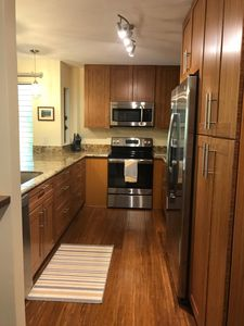 Room for two to comfortably cook in kitchen. Cabinets are bamboo