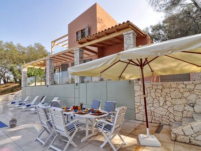 Photo for Luxury villa with private pool next to Avlaki Beach, only two minutes away!