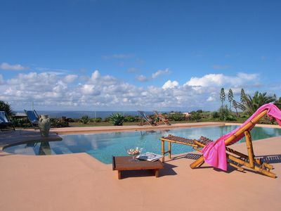 Photo for Dammuso oasis with swimming pool sunset view - Prices per week per person -
