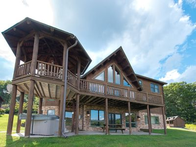 Lake access home with dock slip, hot tub, sauna, pool table and many community amenities!