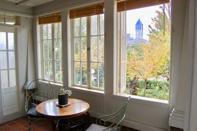 Entrance/Sunroom overlooks the front yard with skyline in the background.