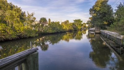 Situated on the canal with 20 foot dock and bench to enjoy the relaxing views.