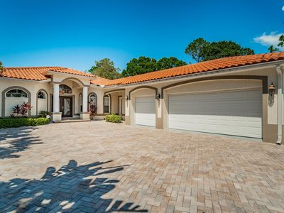 Photo for Lake Tarpon Waterfront, HUGE House, HUGE POOL, Lots Of Wildlife, Kayaks Incl.
