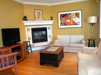 Family room off the kitchen, with tv, dvd/ vcr and stereo sound system.