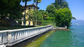 Old luxury villa  with garden in front of the Garda lake