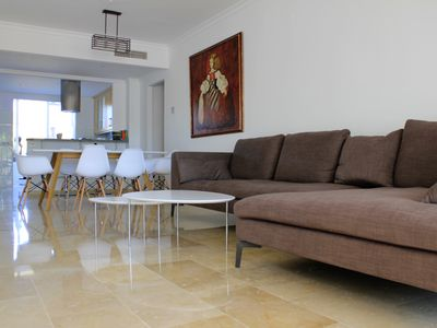 Photo for Spacious modern apartment with a view of nature, golf and 2 km from the beach
