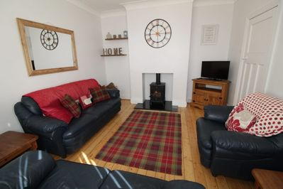 Guest sitting room with log burner for the cooler evenings. Oil fired heating.