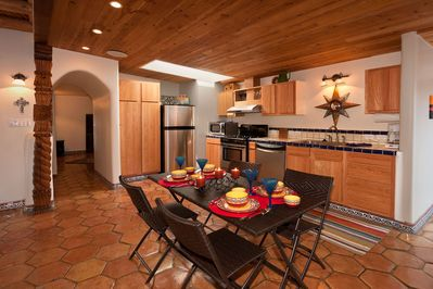 Full kitchen with range, microwave, refrigerator and dishwasher.
