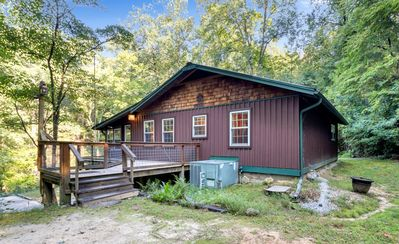 Secluded cabin surrounded by mountains, waterfalls, wildlife, and 50,000 acres