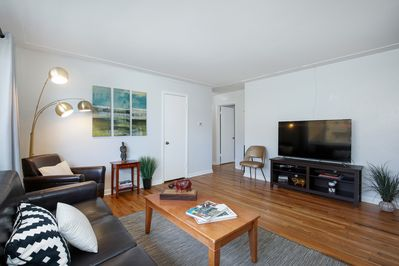 Lovely living room to sit and relax in! Enjoy cable and a smart TV to access Netflix, etc