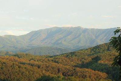 Breathtaking Views of the Beautiful Smokies taken from the Spacious Covered Deck