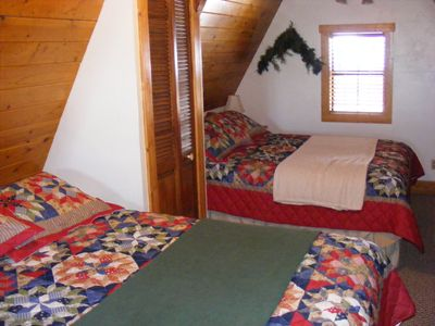 Loft Bedroom with Two Queen-Size Beds and Television with DVD Player