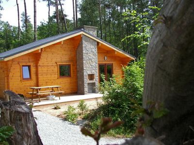 Photo for Modern, wooden chalet with stove, located in the forest