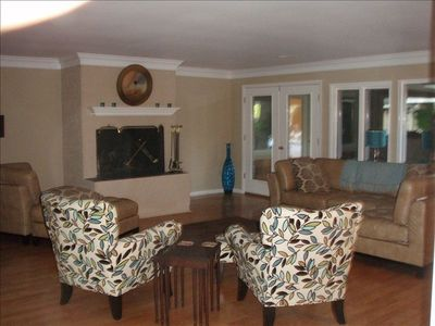 Great Room with sectional sofa, chairs, fireplace and stereo